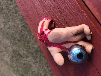 HAND MADE SEVERED ZOMBIE HAND WITH STAINLESS STEEL EYEBALL